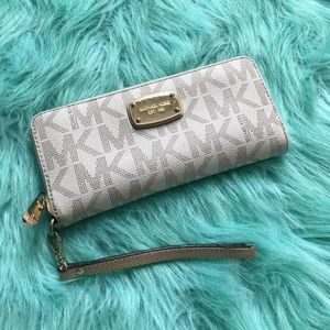 Authentic MK logo wristlet.